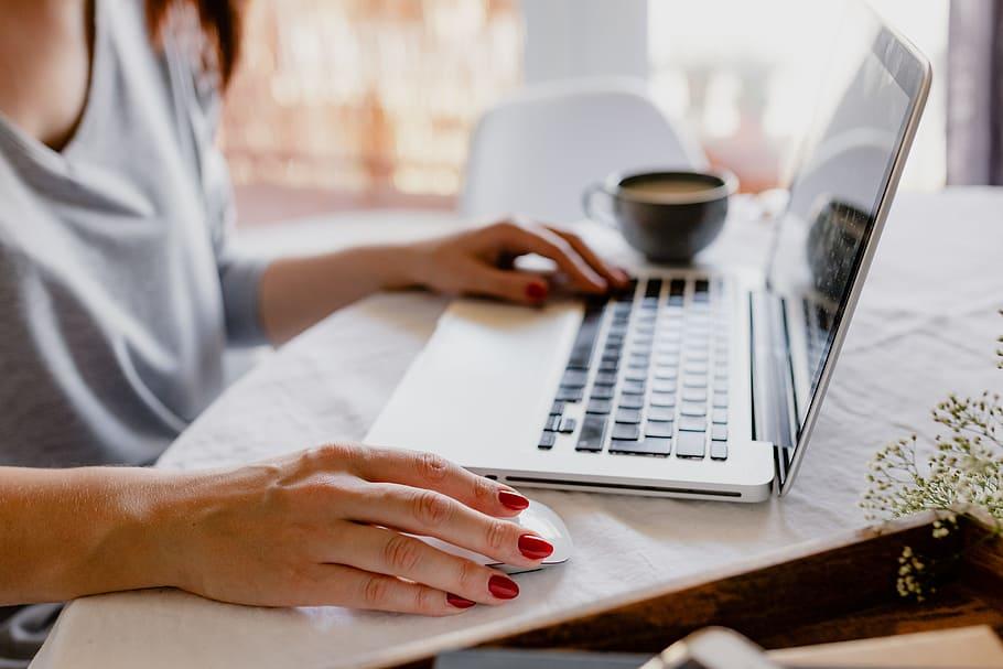 A woman watching our online nursing seminars